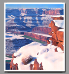 Freshly fallen snow covers the red canyon walls below Dead Horse Point in Utah.