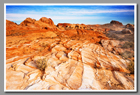 A colorful landscape set against blue skies in Valley of Fire State Park, Nevada.